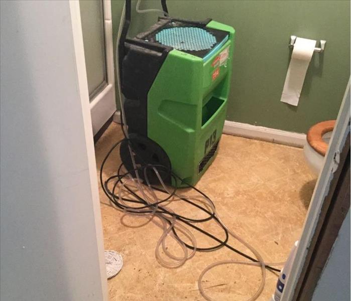 bathroom floor with water damage