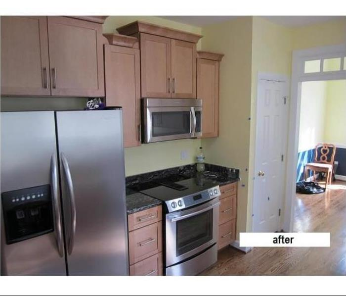 Completely rebuilt kitchen with new finished cabinets & stainless steel appliances